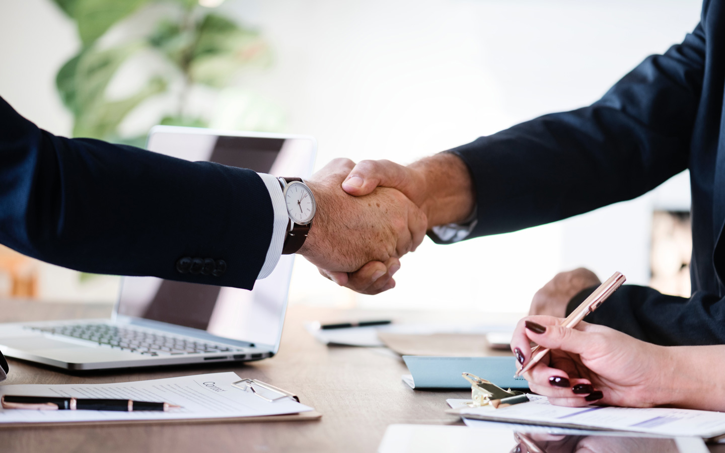 Client and agent shaking hands