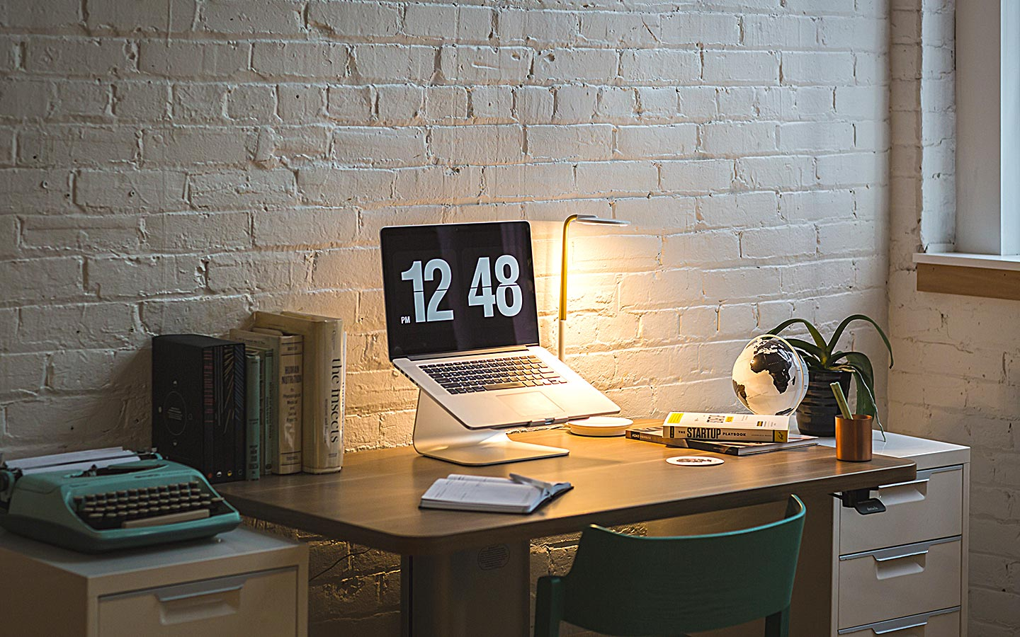 a laptop showing time in a home office