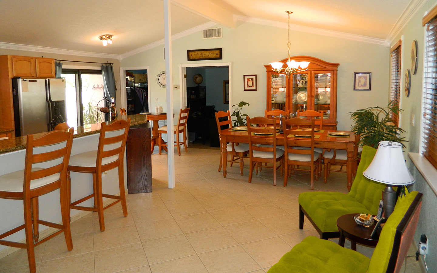 Picture of a dining room with attached kitchen