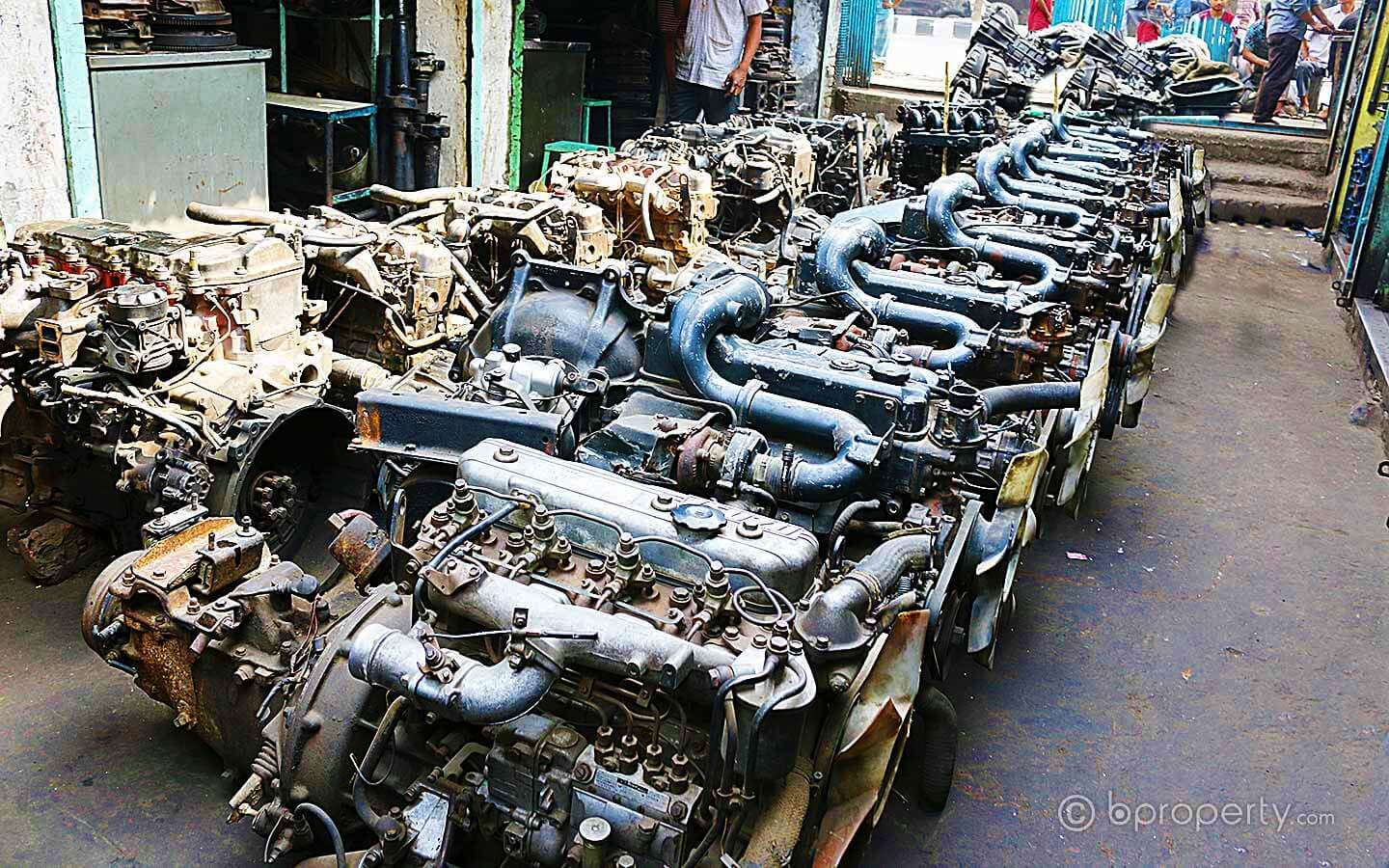 Lined up car engines in Dholaikhal, ready to be replaced as a mod for the new owner