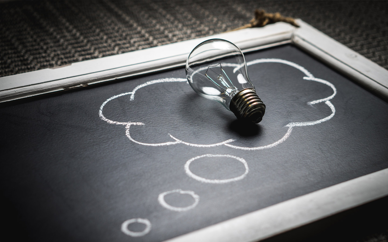 a slate board and a bulb on top
