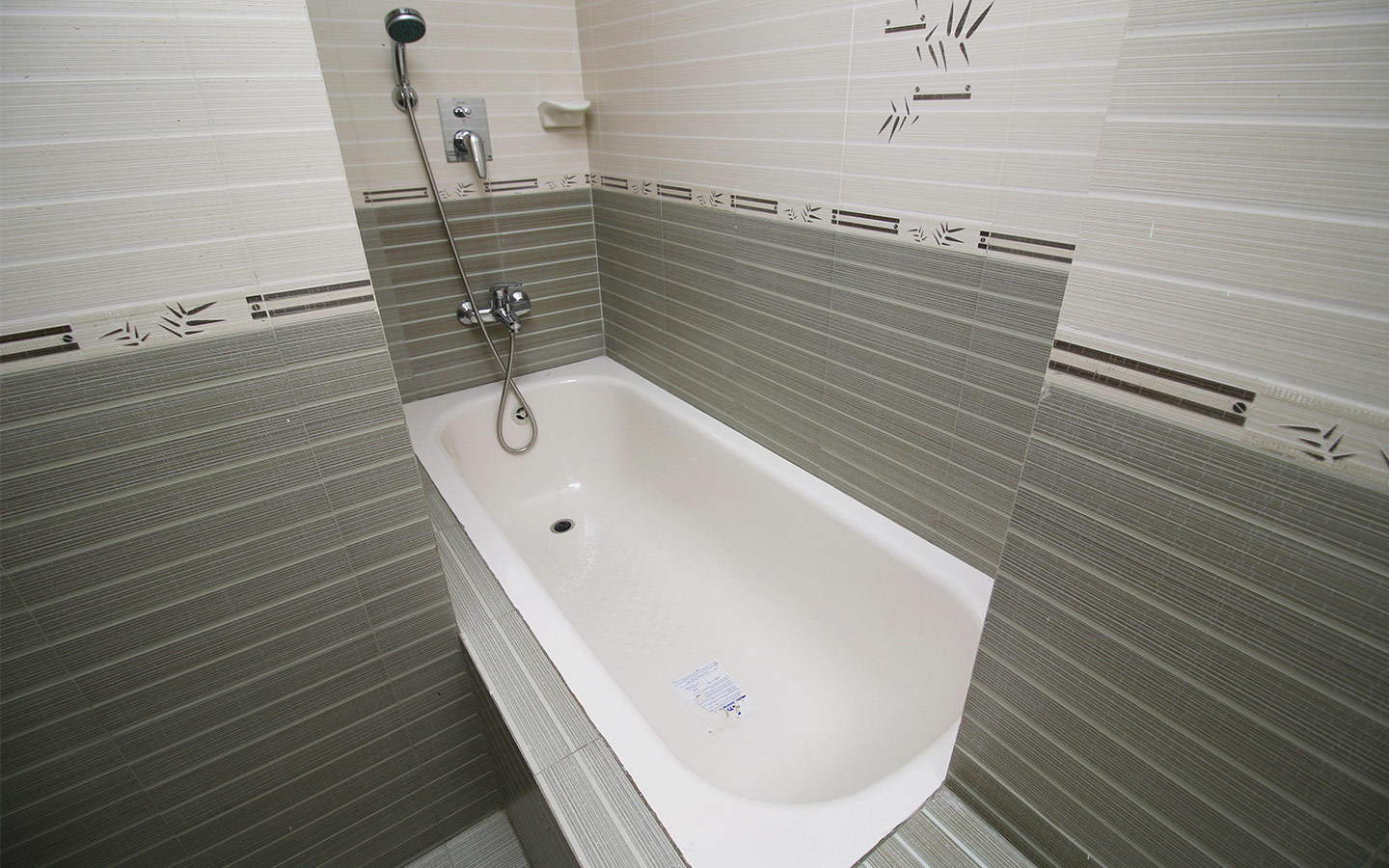 Picture of a bathtub in a congested spacing