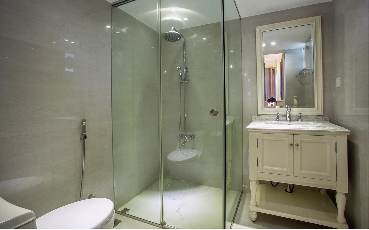 A luxurious washroom having separate shower and storage underneath the basin
