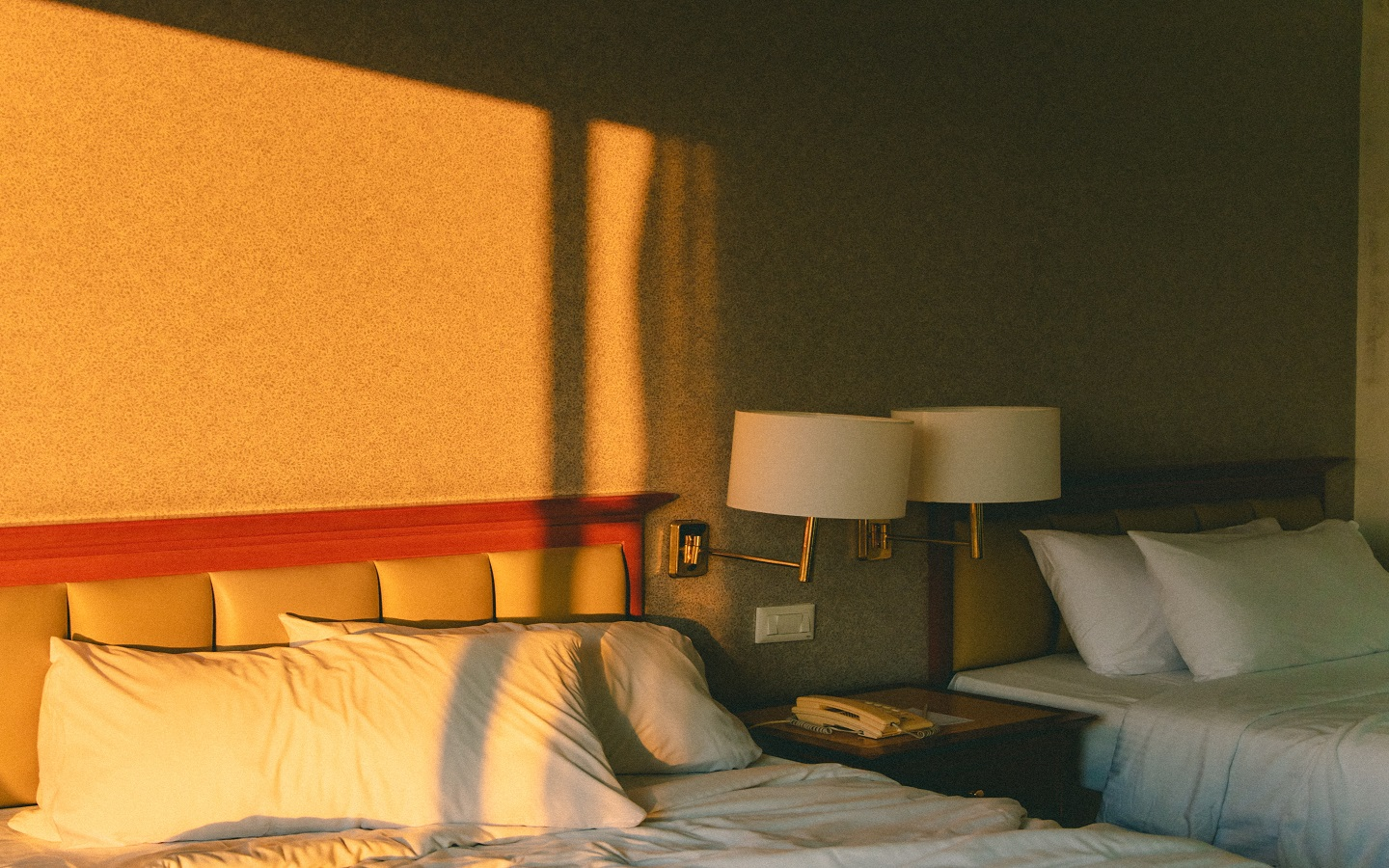 room with two beds and adequate sunlight