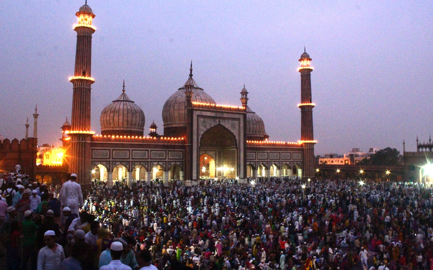 people gathered in front of mosque in India