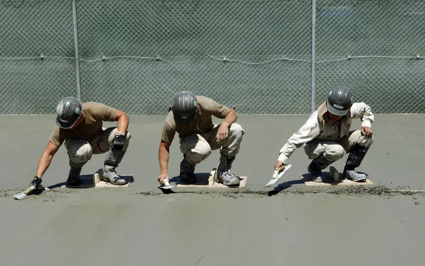 Construction Workers With Cement