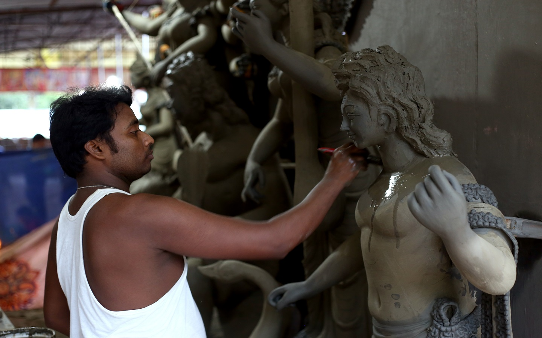 Artist creating idols