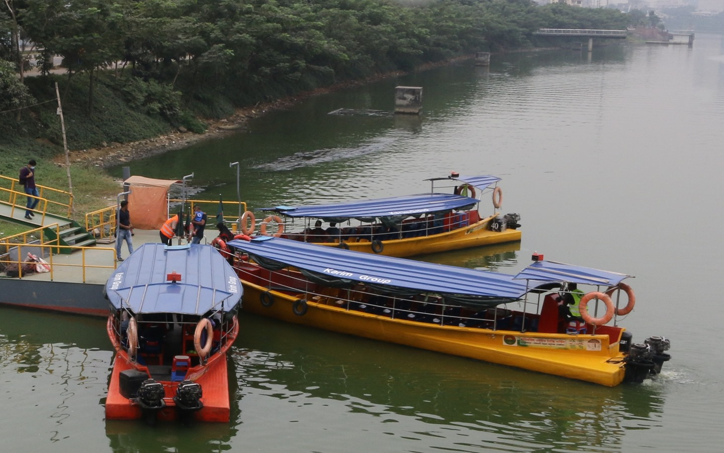 Boats of varying size operate in the Hatirjheel lake