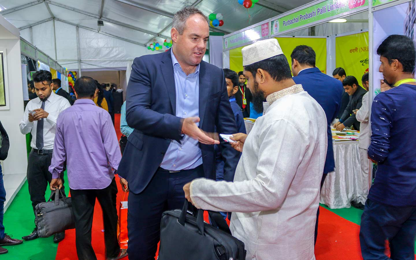 CEO of Bproperty conversing with visitor