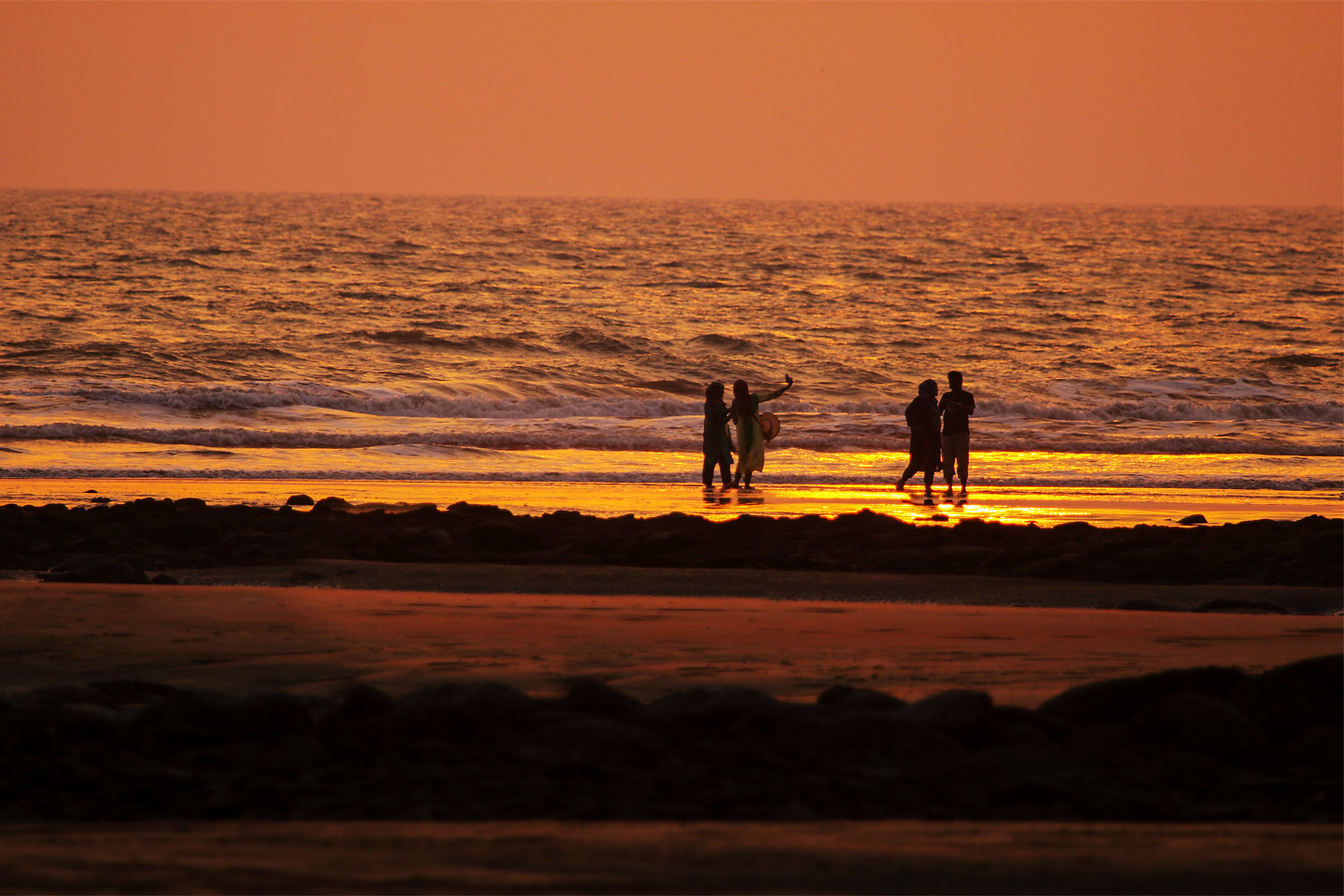 People enjoying by the Bay of Bengal at Dawn- A snippet of lifestyle