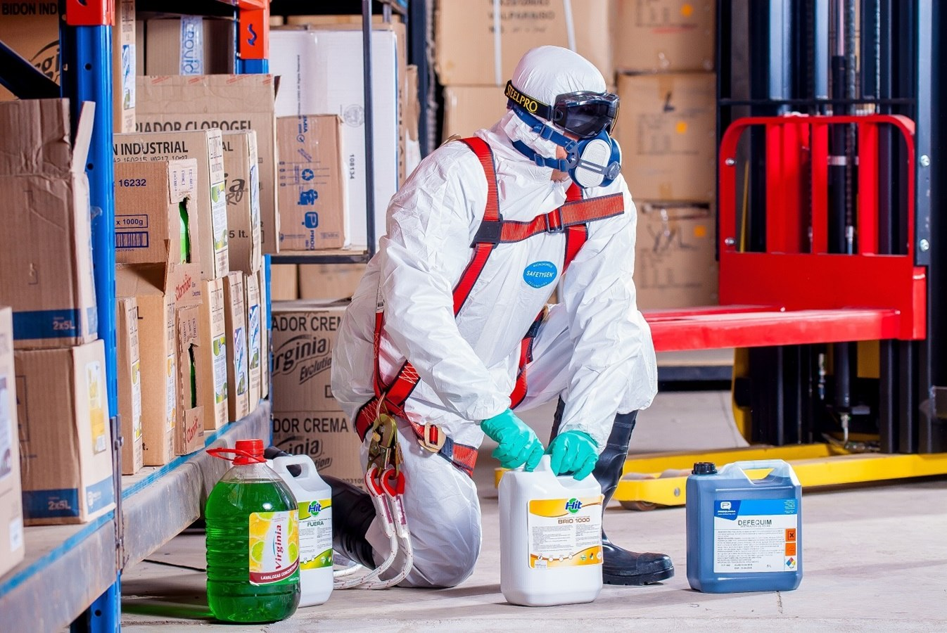 Disinfecting chemicals and a man