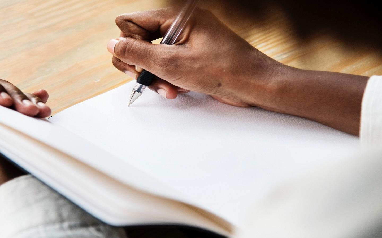 Writing on a white diary