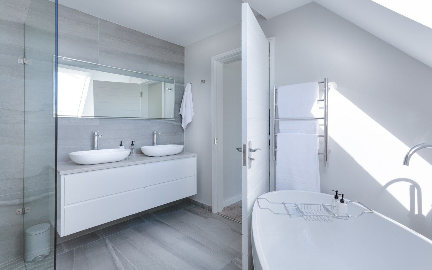 One of the tricks to make small bathrooms feel bigger is to get a statement mirror