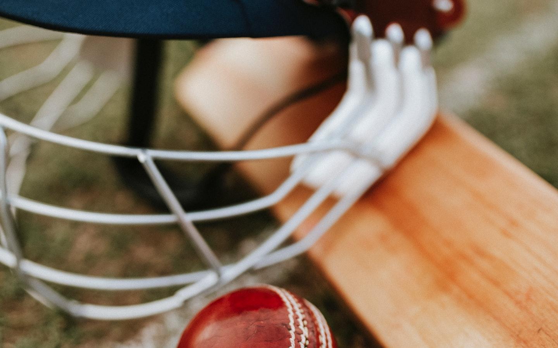Cricket helment, ball, and a bat