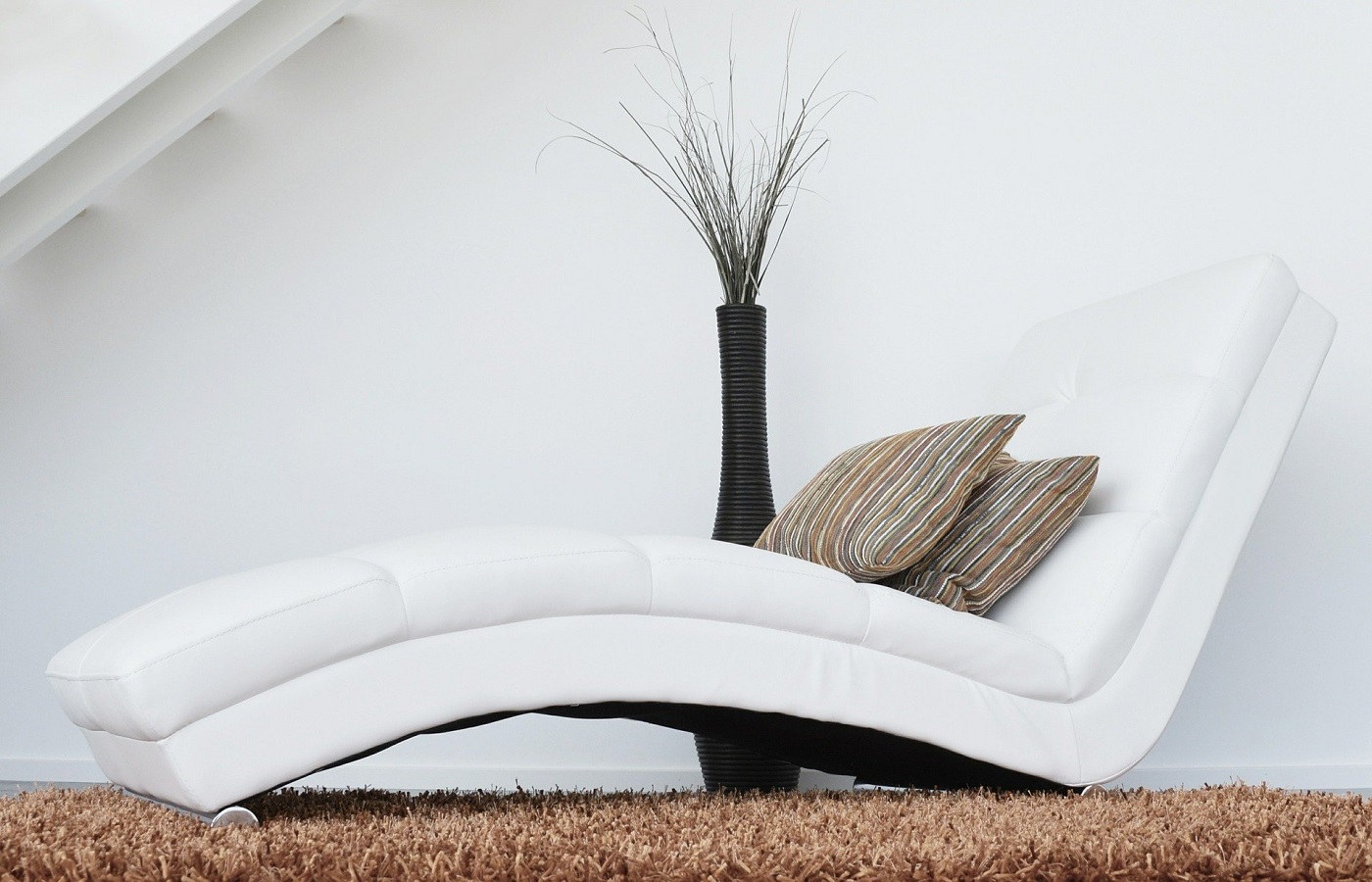 A white classic lounge chair with cushion