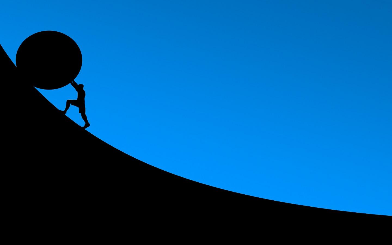 Man rolling stone uphill