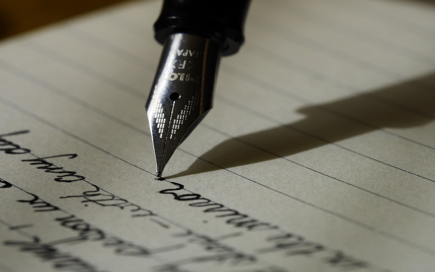writing on a paper with pen