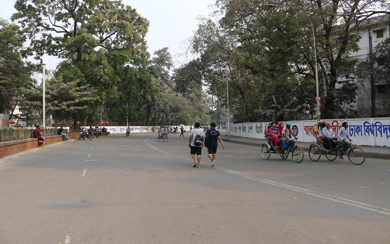 people walking on a empty road