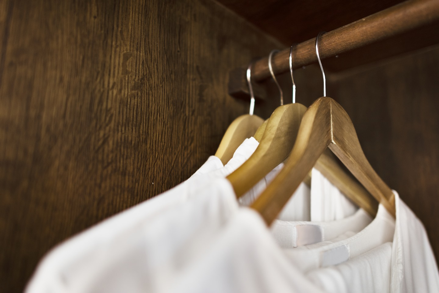 white clothes on hangers
