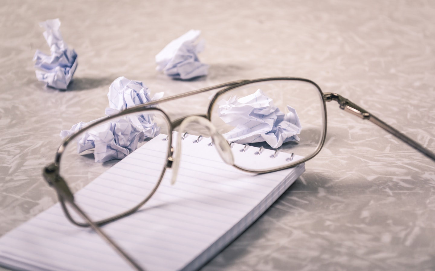 crumpled paper and glasses