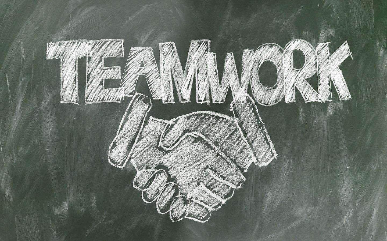 chalkboard with teamwork writenn on it