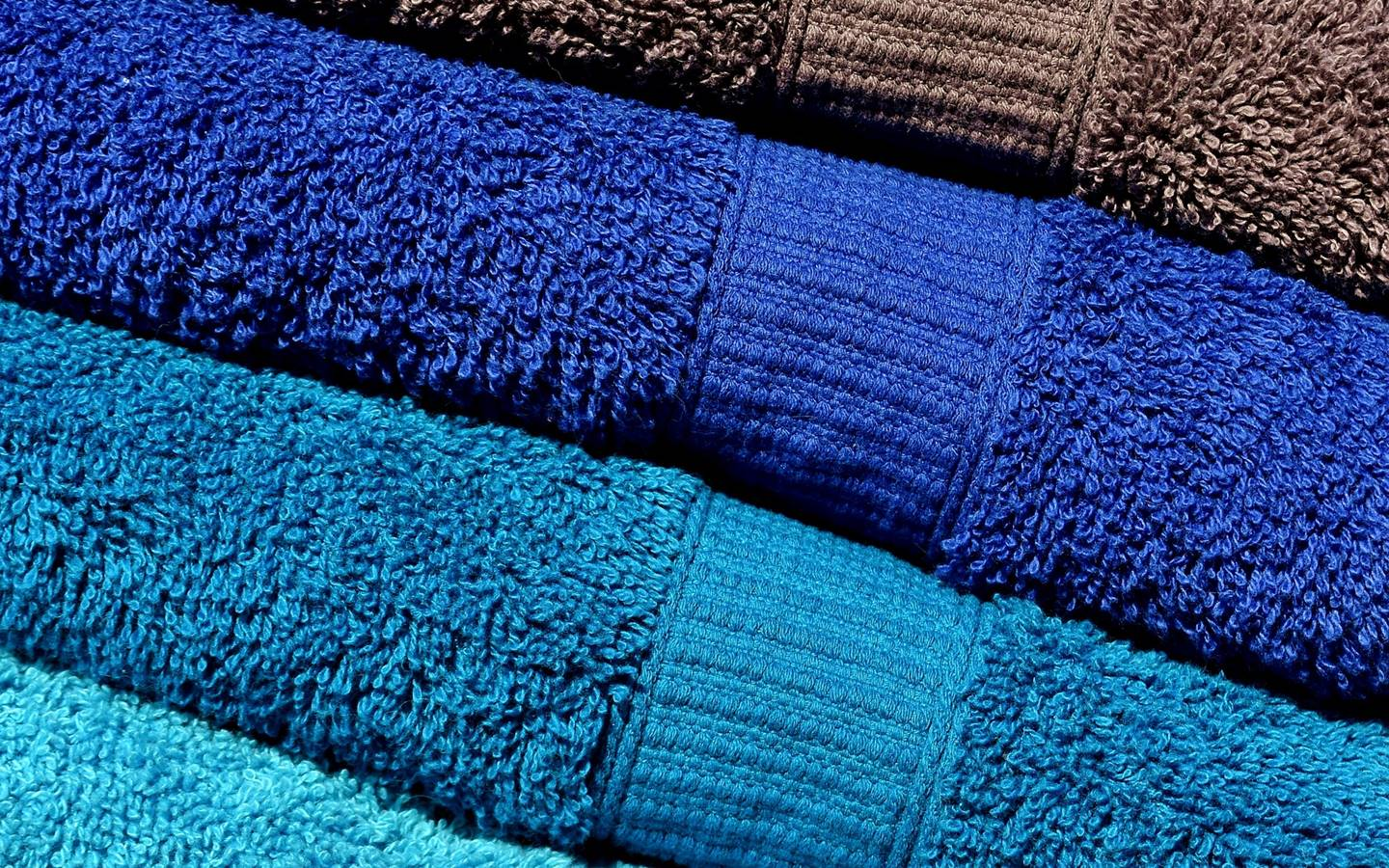 several towles of different colors