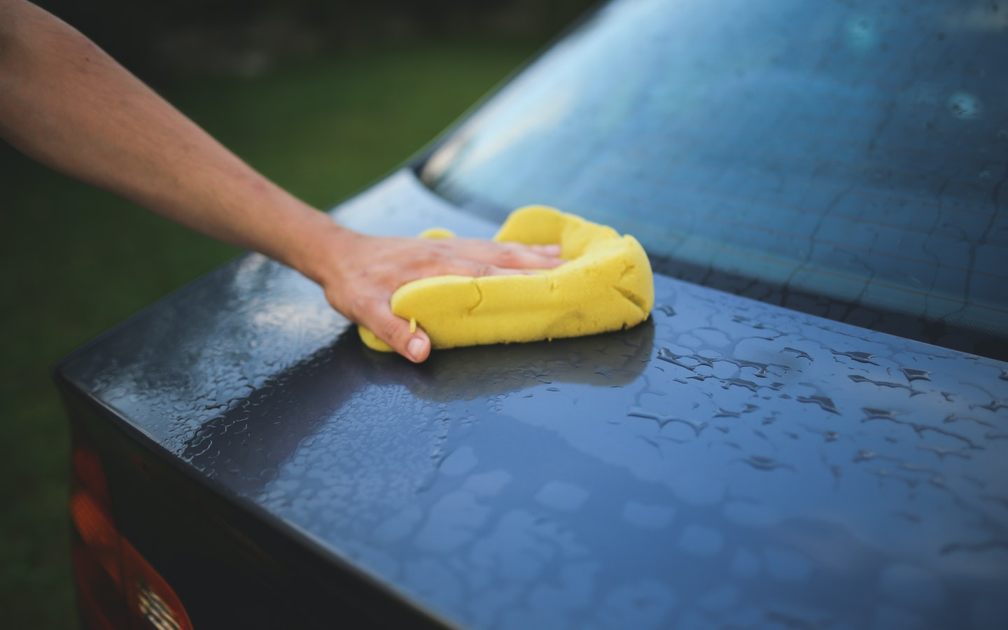 Car being cleaned with sponge
