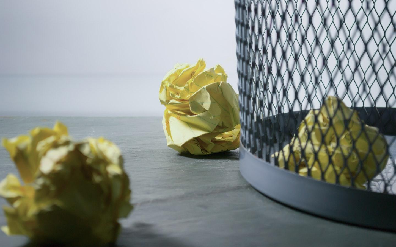 trash around dustbin