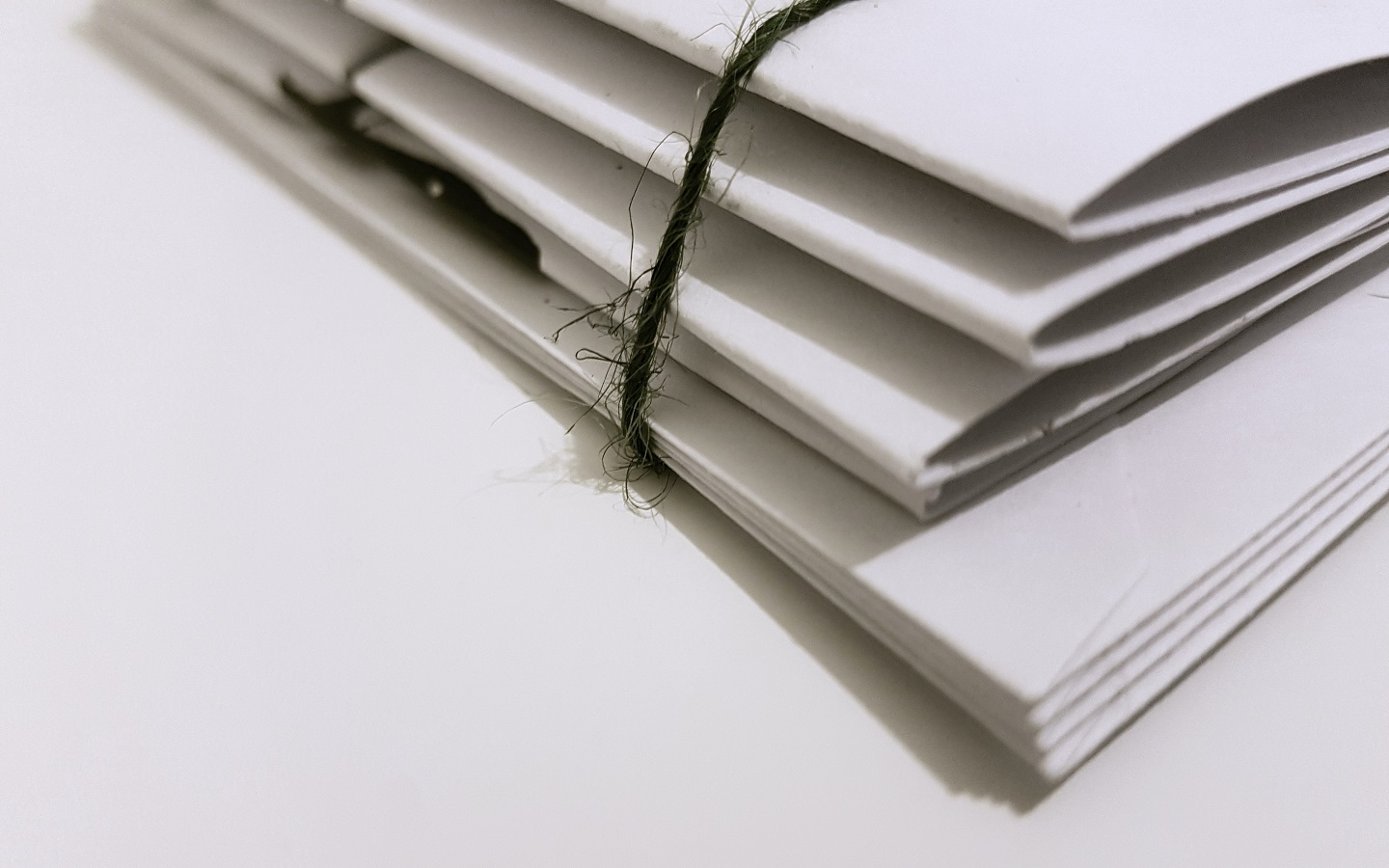 white-paper-folders-with-black-tie
